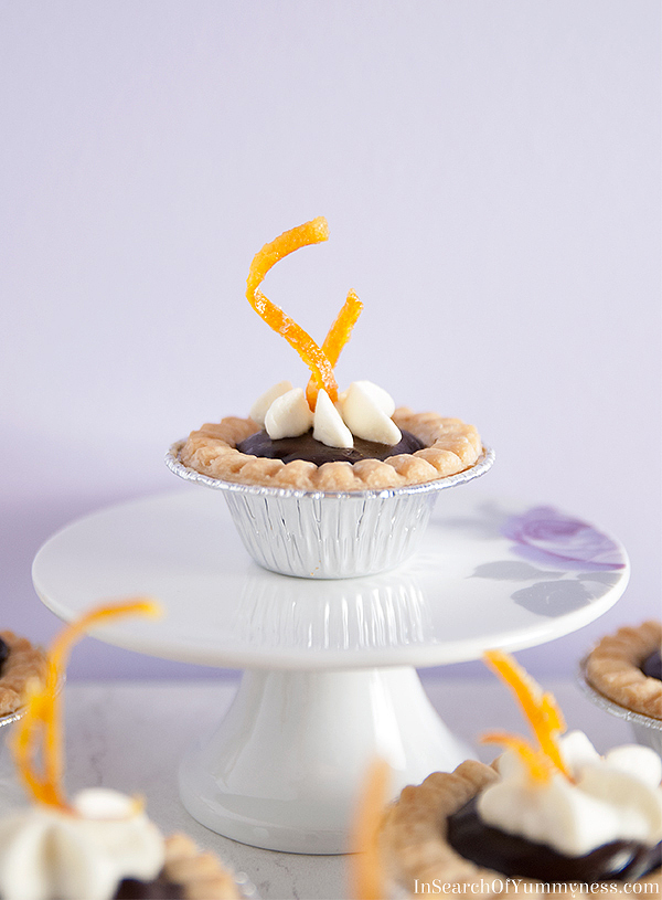 These cute mini tarts are filled with a melt-in-your-mouth chocolate orange ganache, and are topped with a fresh orange cream!
