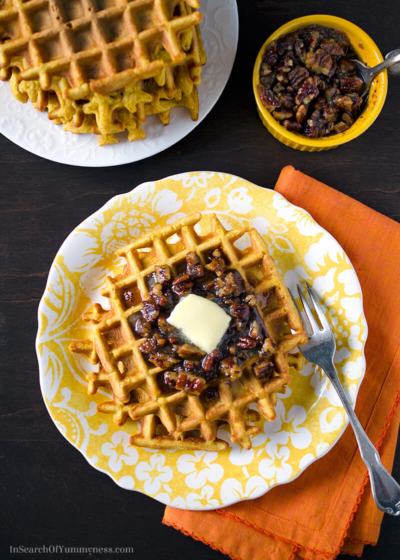 These sweet pumpkin waffles with a hint of pumpkin spice, are a decadent treat when served with pecan syrup! | InSearchOfYummyness.com