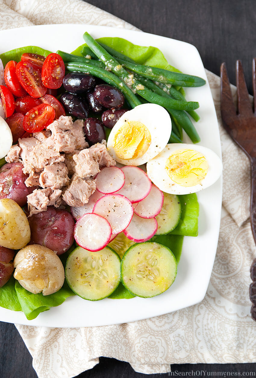My non-traditional Salade Niçoise recipe is made with creamy new potatoes, tender-crisp green beans, juicy tomatoes and more! Get the recipe at InSearchOfYummyness.com