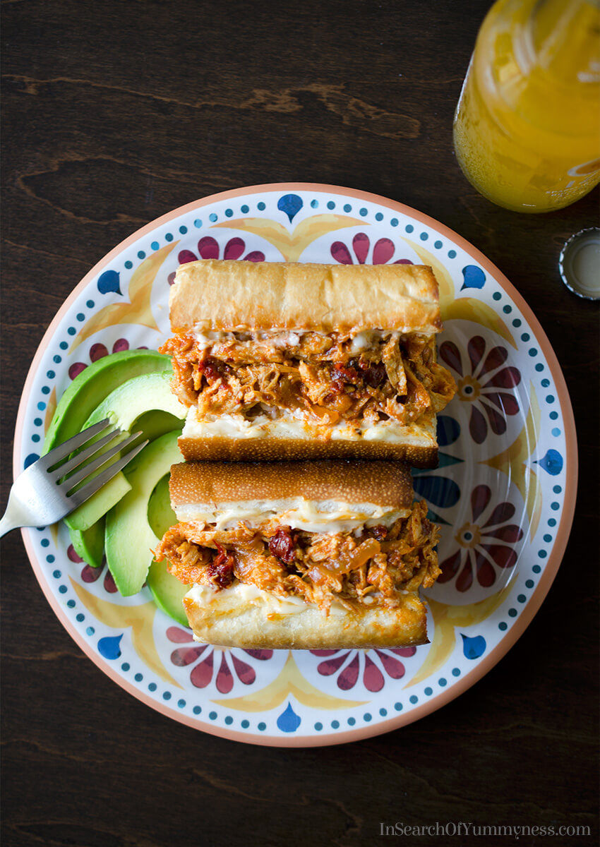 The smoky and spicy flavours of chicken tinga are delicious in this sandwich! Get the recipe at InSearchOfYummyness.com