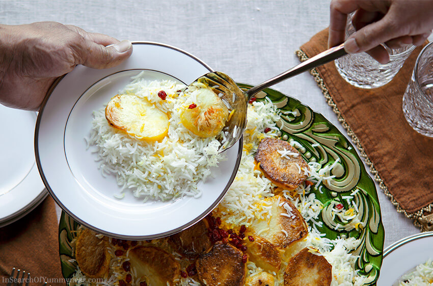 Serving Persian Rice with Potato Tahdig | InSearchOfYummyness.com | Image protected by copyright!