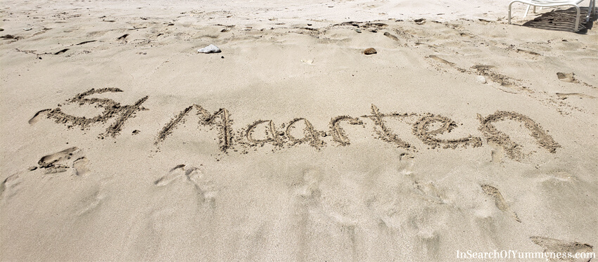 St. Maarten written in the sand | In Search Of Yummy-ness