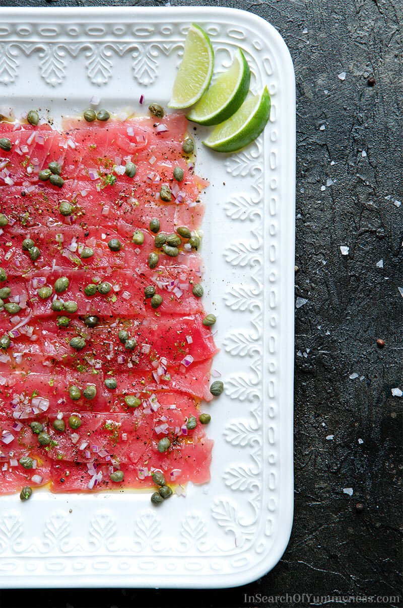 A beautiful platter of tuna carpaccio with capers, red onion and lime. | In Search Of Yummy-ness